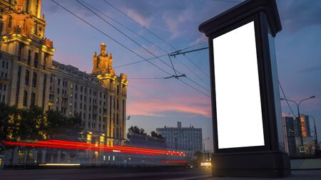 Consumerism, mockup, isolated white screen, template, background, copyspace concept. Mock up image - blank vertical street white billboard poster or advertising pillar and fast moving car at evening. Standard-Bild