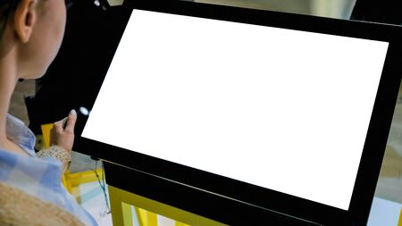 White screen, mockup, science, copyspace, template, isolated, technology concept. Woman looking at blank white display of interactive kiosk at exhibition or museum with futuristic sci-fi interior