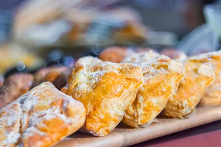 Close up view - assortment of delicious freshly baked sweet and puff pastry for sale on counter of shop, grocery, market, cafe or bakery. Dessert, food and traditional french cuisine concept Reklamní fotografie