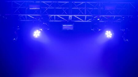 Bright blue concert lighting equipment for stage at nightclub, illumination of entertainment musical show, party or performance. Nightlife, music, entertainment and technology concept Banco de Imagens