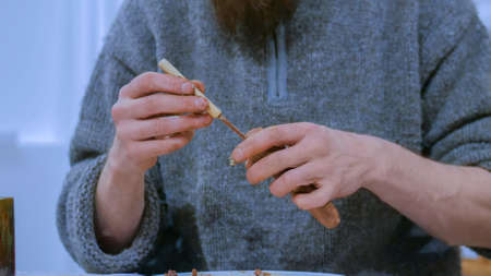 Professional male potter making ceramic tobacco pipe in pottery workshop, studio. Close up shot of man hands. Handmade, art and handicraft concept