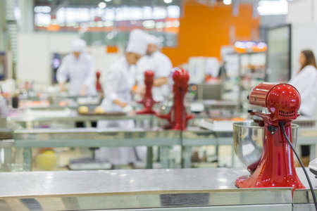 Professional chef, baker workplace with modern kitchen stand food mixers on tables at cuisine of restaurant, bakery. Cooking, catering, culinary, gastronomy and food concept