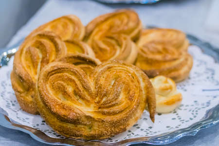 Freshly baked heart shaped buns on plate at cuisine of restaurant, bakery. Professional cooking, catering, culinary, bakery, gastronomy and food concept