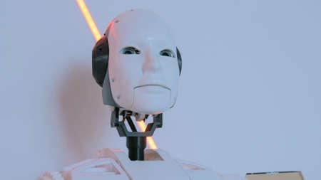 White humanoid robot head at technology exhibition. Future and robotic concept Foto de archivo
