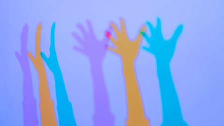 Interactive exposition in science museum. Colored shadows of woman hands. Science, optical and physics concept