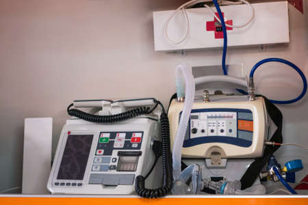 Inside an ambulance with medical equipment, close up shot
