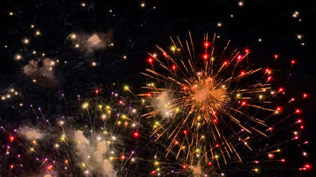 Holiday, celebration and anniversary concept. Colorful bright fireworks in dark sky at night. Evening time, low light illumination Stok Fotoğraf