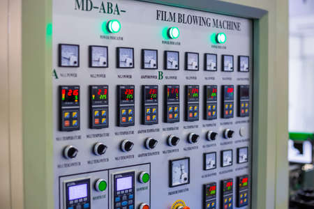 MOSCOW, RUSSIA - JUNE 05, 2019: Plastic exhibition. Smart control panel of film blowing machine - terminal, console, interface at plant or factory: close up. Technology, production, industrial concept Редакционное