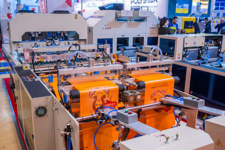 MOSCOW, RUSSIA - JUNE 05, 2019: Package exhibition. Fully automatic high speed shopping bag making machine with servo driving system at trade show