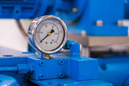 Glycerin pressure gauge for measuring fluid condition at plant, facory - close up. Industrial, electronic, technology equipment concept Фото со стока