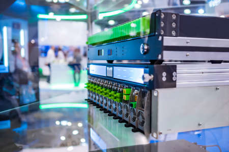 Upstream dual receiver, optical amplifier, codec module - telecommunications equipment at broadcasting exhibition, trade show - close up Stok Fotoğraf
