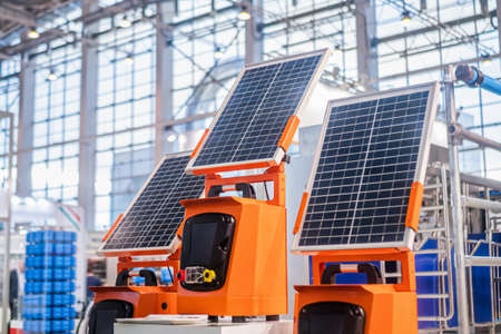 Automatic portable photovoltaic solar panels working at modern technology exhibition. Solar tracking system, alternative electricity source, sustainable resources, renewable energy, ecology concept