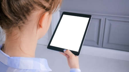 Mockup image - woman looking at digital tablet computer device with white blank screen - close up view. Mock up, entertainment, copyspace, template, leisure time and technology concept