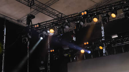 Colorful bright concert lighting equipment for stage at nightclub, illumination of entertainment musical show, party or performance. Nightlife, music, entertainment and technology concept Standard-Bild