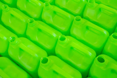 Many empty green plastic jerrycans background in warehouse, market, factory or exhibition - close up