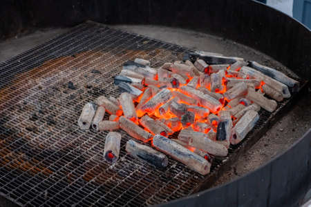 Hot charcoal on big round grill at local barbecue food market - close up view: nobody, no people Standard-Bild
