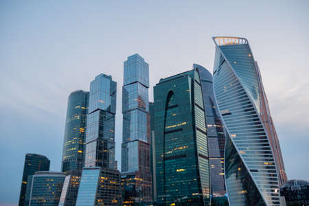 Modern tall office buildings, luxury apartments, glass skyscrapers at city downtown against evening sky. Moscow International Business Center. Architecture, corporate, financial and cityscape concept