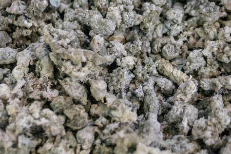 Heap of secondary soft plastic granules - polystyrene, polyethylene, polypropylene pellets at exhibition, trade show - plastic recycling, renewable resource: close up top view Standard-Bild