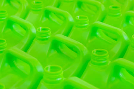 Many empty green plastic jerrycans background in warehouse, market, factory or exhibition