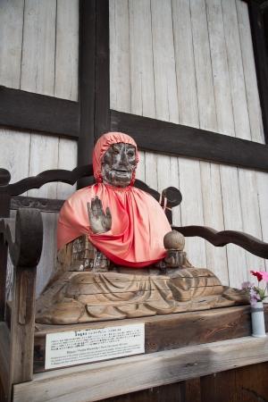 divinity: Pindola divinity wooden statue at Todaiji temple, Nara, Japan