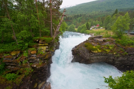 Roaring waterfalls and beautiful mountain rivers of Norway photo