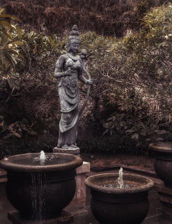 The old stone statue. Indonesia, Bali. Stock Photo