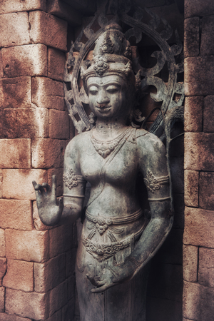 The old stone Buddha statue. Indonesia, Bali.