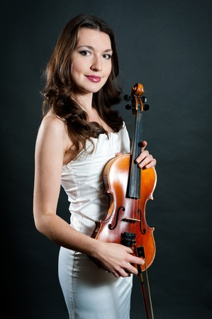 solo violinist: violinist on black background Stock Photo