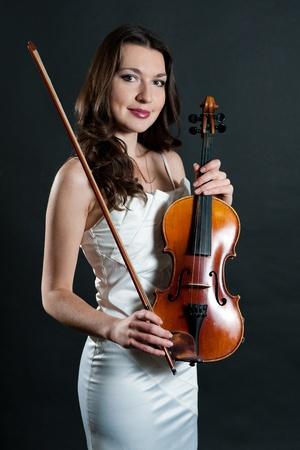 solo violinist: violinist on black background Stock Photo