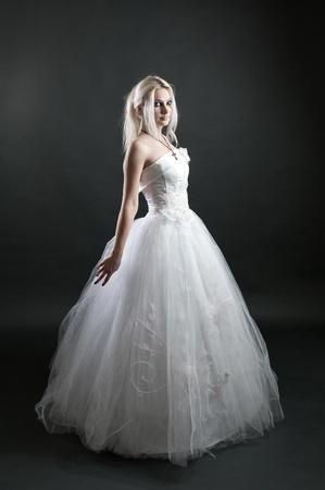Beautiful girl in white dress on black background Stock Photo