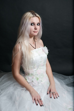 damsels: Beautiful girl in white dress on black background Stock Photo