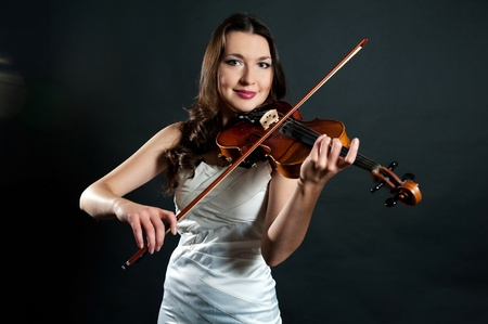 solo violinist: violinist on a black background Stock Photo