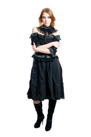 gothic girl in black dress isolated on white background photo