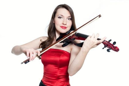 Violinist girl in red dress isolated on white background photo