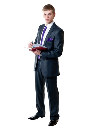 The young businessman in a suit with daily log isolated on white background photo