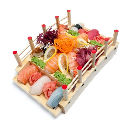 fruit platter: Set of sushi on wooden stand in the form of the bridge isolated on white