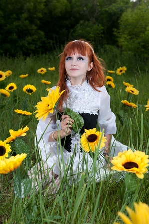 haired: red-haired nymph in a white dress on a fairy glade