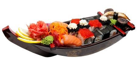 set of sushi on wooden stand in the form of the boat isolated on white photo