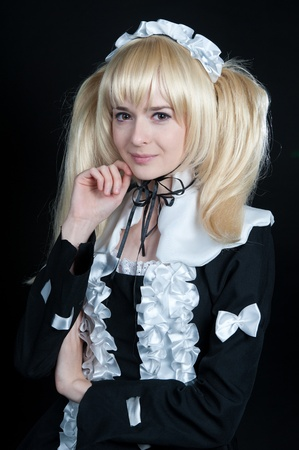 lolita: portrait of young girl in anime lolita suit on black background Stock Photo