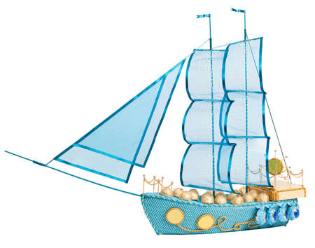 ship with gift: gift in form layout sailing ship decorated with candy isolated on white