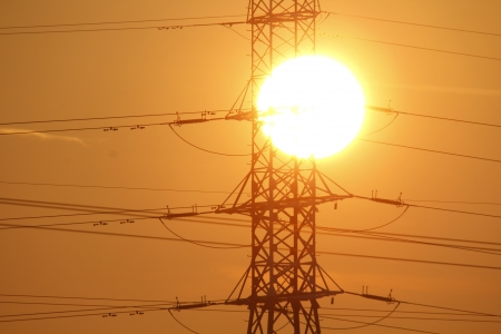 The power lines with the sun in the background photo