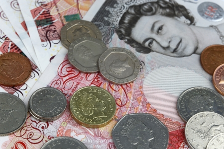 Uk sterling money notes and coins for business photo