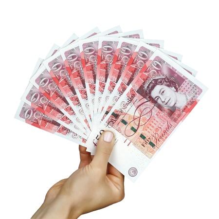 Reino Unido libras esterlinas de dinero en la mano Foto de archivo - 21691309