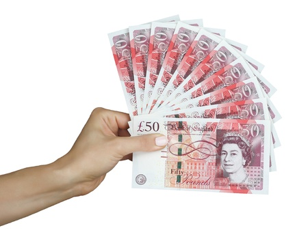Britse pond sterling geld ponden in de hand Stockfoto