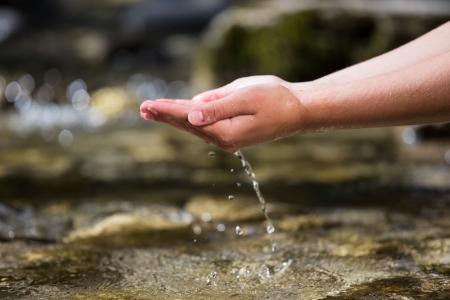 川から水を出して手 写真素材