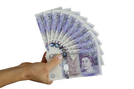 pounds money: Del Reino Unido en libras esterlinas de dinero libras en la mano Foto de archivo