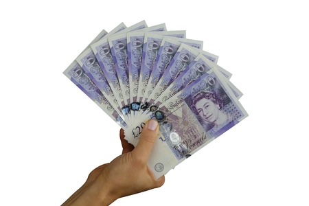 residue: UK sterling money pounds in the hand Stock Photo