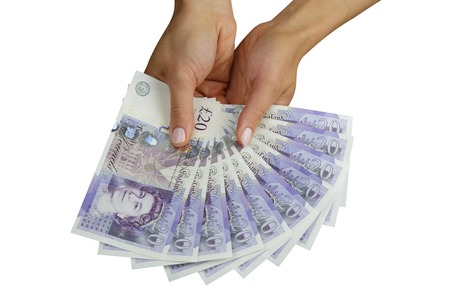 money pounds: UK sterling money pounds in the hand Stock Photo