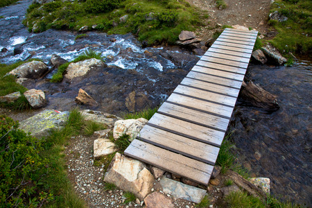 Small bridge in high mountains alps Austria photo