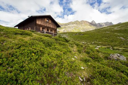 dandelion snow: Small house in high mountains Alps Austria